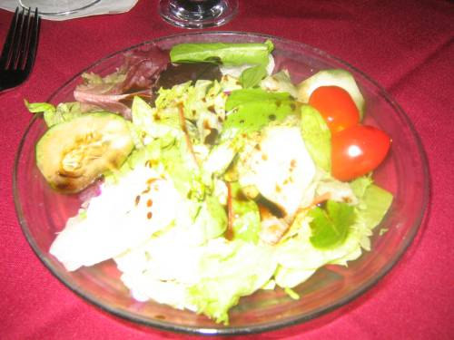 Mixed green salad with oil and balsamic vinegar